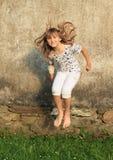 Jumping smiling girl Stock Photo