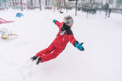 Jumping in snow. Happy carefree kid jumping in snow, winter joy Royalty Free Stock Images