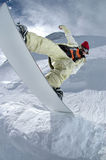 Jumping snowboarder Royalty Free Stock Photos