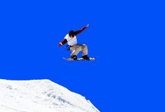Jumping snowboarder Stock Image
