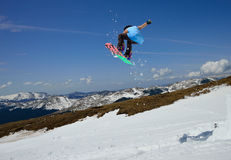Jumping snowboarder. In Carpathian mountains stock image