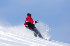 Jumping snowboarder from hill in winter Stock Images
