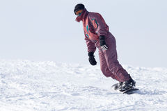 Jumping snowboarder from hill in winter Royalty Free Stock Photography