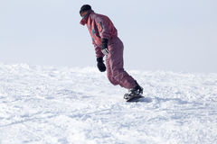 Jumping snowboarder from hill in winter Stock Photography