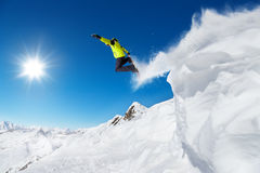 Jumping snowboarder at jump Royalty Free Stock Photography