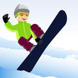 Jumping snowboarder keeps one hand on the snowboard Royalty Free Stock Images