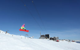 Jumping Snowboarder stock photography