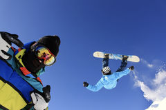 Jumping Snowboarders stock photo