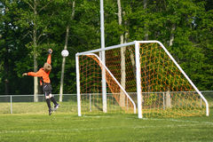 Jumping soccer goalie. Image of soccer goalie getting scored on Royalty Free Stock Photos