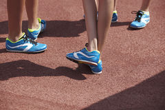 Jumping sport shoes in the athletic field ground Royalty Free Stock Photos
