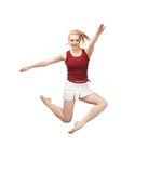 Jumping sporty girl Stock Photo
