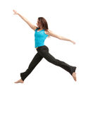 Jumping sporty girl Stock Photography