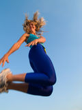 Jumping sporty girl royalty free stock photography