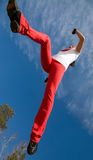 Jumping sporty woman royalty free stock photos