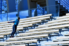 Jumping on stadium stairs. Royalty Free Stock Photography