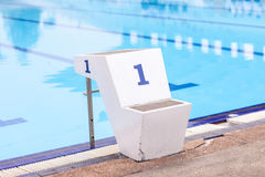Jumping stantd Number 1 in swimming pool Royalty Free Stock Photography