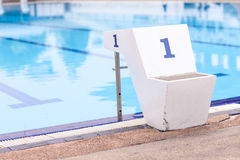 Jumping stantd Number 1 in swimming pool Royalty Free Stock Images