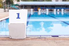 Jumping stantd Number 1 in swimming pool Stock Images