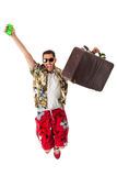 Jumping stereotype tourist. A young, attractive male in a colorful outfit ready to travel as a stereotype tourist Stock Photography