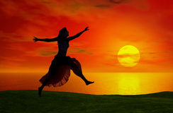 Jumping at the sunset Stock Images