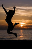 Jumping in sunset Royalty Free Stock Photography