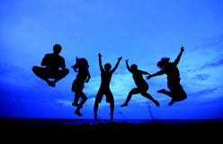 Jumping team. 5 persons jumping team as silouette Stock Photography
