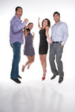 Jumping Team. Group of multiracial young adults jumping and having fun in positive attitude Royalty Free Stock Images