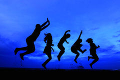 Jumping team blue sky Royalty Free Stock Photo