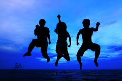 Jumping team at sunset time Royalty Free Stock Image