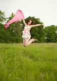 Jumping  teen girl Stock Photo