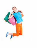 Jumping teen girl holding shopping bags Stock Photography