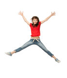 Jumping teenage girl. Bright picture of happy jumping teenage girl Royalty Free Stock Image