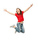 Jumping teenage girl. Bright picture of happy jumping teenage girl Royalty Free Stock Photos