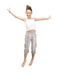 Jumping teenage girl. Bright picture of happy jumping teenage girl Royalty Free Stock Photo