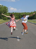 Jumping teenagers. Funny jumping teenagers on the road Stock Image