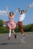 Jumping teenagers. Funny jumping teenagers on the road Royalty Free Stock Photos