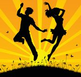 Jumping teens. Jumping happy teens on the sunset Royalty Free Stock Images