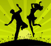 Jumping teens. Jumping youngsters having fun in the field Stock Photography