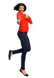 Jumping and thumbs up Royalty Free Stock Image