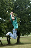 Jumping to catch a frisbee royalty free stock image