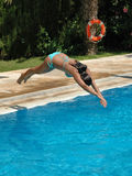 Jumping to the pool. Girl jumping to the water Royalty Free Stock Photography