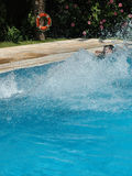 Jumping to the pool Royalty Free Stock Photo