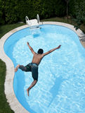 Jumping to pool. A young man is jumping to a pool in a headfirst style Stock Photography