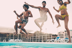 Jumping to the pool. Stock Photography