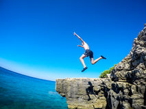 Jumping in to the sea Stock Photography