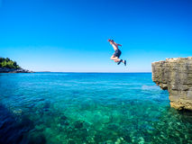 Jumping in to the sea Royalty Free Stock Photos