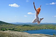 Jumping to the sun Royalty Free Stock Image