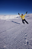 Jumping at the top of the glacier. Les Deux Alps in december after nice snowfall Stock Photos