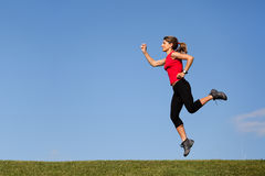 Jumping at the top of the hill Royalty Free Stock Photos