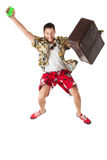Jumping tourist. A young, attractive male in a colorful outfit ready to travel as a stereotype tourist Royalty Free Stock Images